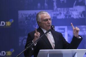 """Temer reiterou as mensagens de otimismo que têm sido repetidas pelo governo e disse que seu objetivo no fórum desta semana será o de """"mostrar o que é o novo Brasil"""""""