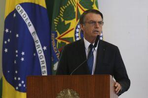 Jair Bolsonaro (PSL) usou o símbolo do infinito no material visual exibido na cerimônia de cem dias de mandato